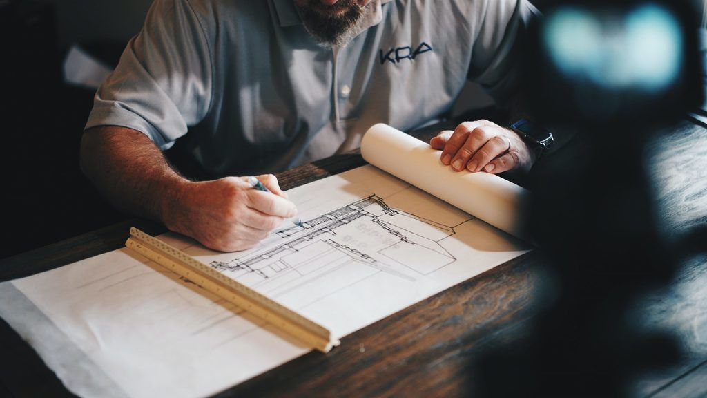 Learn about the requirements for building a passive house. If you want a 100% successful project, you need to choose carefully. Every architect or engineer knows how to make a blueprint, but only some of them are familiar with the concept of passive objects. Even fewer know the rules and the ways to apply them. (Image: Architect with a plan)